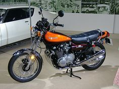 """The Kawasaki Z1 was developed in strict secrecy under the project name """"New York Steak"""".[8][9] In the late 1960s Kawasaki, already an established manufacturer of two-stroke motorcycles, decided to make a 750 cc four-cylinder four-stroke sports motorcycle[2] (they even had an appearance prototype designed by McFarlane Design in 1969),[11] but they were beaten to the marketplace by the Honda CB750. This postponed the Z1′s release until its displacement could be upped to 903 cc.[2]"""