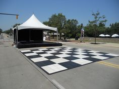 20 x 20 festival frame tent with black & white dance floor. Perfect for community festival, street fest, county fairs, and community concerts! 844-TENT PRO