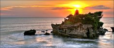 Tanah Lot, Bali. Beautiful temple on the sea. Spectacular sunset.