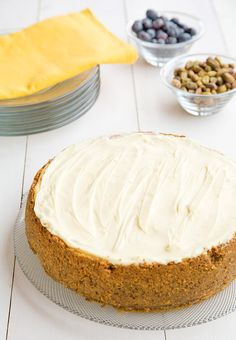 You'll love this creamy smooth Meyer Lemon Mascarpone Cheesecake with a white chocolate topping and pistachio crust. The perfect dessert for any occasion.