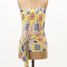 Anthropologie strapless jersey tank A dramatic side tie anchors this Ric Rac strapless top (make it more flowy or more fitted), built in shelf bra, sticky edge along the top to keep it in place, 100% rayon. Anthropologie Tops