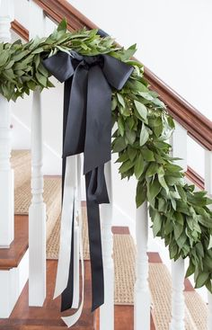 Black, white, and green Christmas house tour. Bay leaf garland with black and white ribbon
