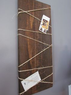Simple & rustic memo/picture board...stained wood plank and twine.