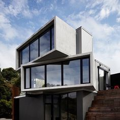 Completing our roundup is this guesthouse  near Australia's Great Ocean Road which comprises stacked concrete and timber boxes by Melbourne studio Whiting Architect. Photography is by Sharyn Cairns. If you enjoyed our roundup of popular concrete houses visit http://ift.tt/1MQ8xKV for more examples #architecture #concrete #house by dezeen