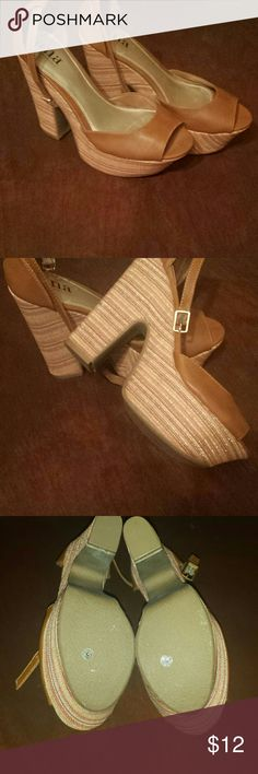 a.n.a platform heels NOT NEVER WORN definitely retro look tan top, heel part is multi-colored with gold threads running game through them. Really cute shoes bought based on look ended up being too big for me! 61/2 a.n.a Shoes Platforms