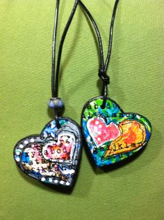 """Lucy's Lampshade: Chunky heart necklaces - I started playing around with some scraps of gelli printed papers, and some heart punches, hoping to piece together a """"mini"""" mixed media piece on some chunky wooden hearts.  I turned the two pictured into necklaces by drilling a small hole and using leather cording."""