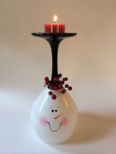 This happy snowman will bring visual warmth to any table or mantle. It is an inverted 20 oz wine glass double painted by hand and baked for