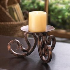 This rustic scrollwork candle stand is crafted with character and style. The scrolling base holds a platform that awaits the candle of your choice, and this beautiful stand will be a striking testament of your great decorating sense. Floor Candle Holders, Modern Candle Holders, Large Candle Holders, Candle Holder Decor, Candle Stands, Candle Lanterns, Votive Candles, Candle Sconces, Pedestal Stand