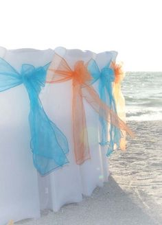 Crisp white chair covers make the colors stand out