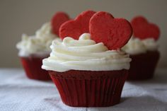 Red velvet cupcake with butter cream and red velvet cookies