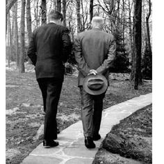 The 1962 Pulitzer Prize-winning photograph of President John F. Kennedy and former President Dwight D. Eisenhower walking together at Camp David following the Bay of Pigs invasion.