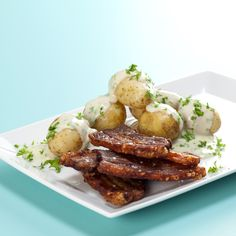 'Stegt flæsk med persillesovs' - Fried slices of juicy pork with tasty potatoes and creamy parsley sauce is Denmark's national dish.