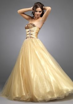 Fabulous full length tulle ball gown in gold, by Scarlett Evenings.