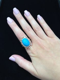 Oval turquoise and diamond scroll ring in rose gold.