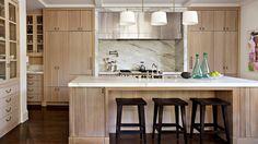 Warming up to wood cabinets.  Marble slab backsplash, stunning!