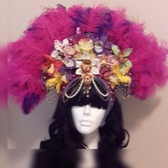 Purple and hot pink ostrich feather with multi colored orchids adorned with Swarovski crystals and Looking Glass Gems. Handmade one of a kind, great for a festival goer, dancer, performer or someone who just wants to stand out in the crowd and look stunning dripping in diamonds and jewels.. | Shop this product here: http://spreesy.com/GypsySparkle/23 | Shop all of our products at http://spreesy.com/GypsySparkle    | Pinterest selling powered by Spreesy.com