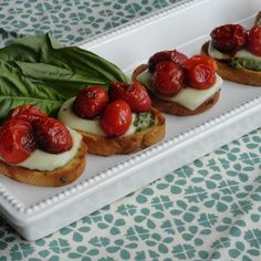 I love Mozzarella and tomatoes. This is a great appetizer with roasted tomatoes,a little pesto. Top with Mozzarella,and so yummy. Holidays are upon us,and who doesn't need an easy appetizer to serve to guests? Easy and so tasty!