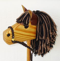 Hobby Horse - Wooden Stick Horse - Waldorf Toy - Imagination Toy - Brown/Black - Hill Country Woodcraft. $40.00, via Etsy.