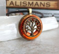 Orange and brass tree of life necklace
