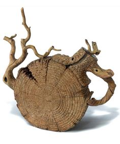 """Ceramic Tea Pot, Ah Leon (China born 1953) Leon started out as a painter but soon learned about Yixing pottery, China's 500-year-old teapot-making tradition. On a visit to the United States, his mastery of this ancient art came face to face with the inventive freedom of Western ceramists, Leon decided to embrace both.  His teapots evolved and mutated until they were not so much teapots as, in the artist's words, """"sculpture with teapot features""""."""