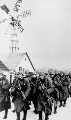 """Wehrmacht in Denmark. The original comment with this pin was: """"Nazi soldiers in Holland"""". I'm 100 % sure this isn't Holland. The windmill on the pin is typical for Denmark. It's a windmill based on the Poul la Cours design . Poul la Cours was a Danisch windmill pioneer."""