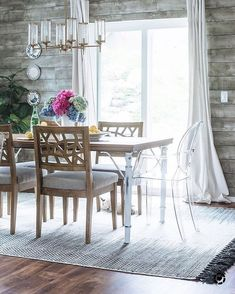 @houseof5five perfectly mixed #modern chairs into her traditional dining room by using our Ghost Arm + Crackle Side Chairs. Score this #diningroom by shopping the link in our profile. #mymodern