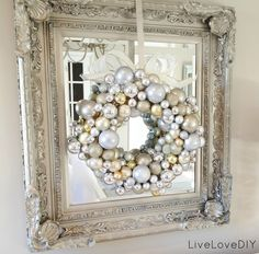 DIY ornament wreath: $7 and less than an hour to make -- my kind of craft project! And adore the idea of hanging it in front of this mirror. Genius!