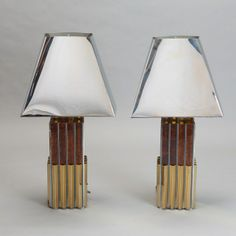 Stunning Pair of Mid Century Table Lamps --- Very unusual pair of mid century table lamps have shiny aluminum / metal shades, ridged metal bases in contrasting gold, silver and coppery/tortoise finish. New wiring for US electrical standards. Height shown is with shades attached. Width shown is for the base. ---  Item:  4090 --- Retail Price:  $1995