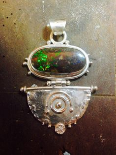 Boulder opal and sterling silver pendant by Gecko Skin Jewellery.