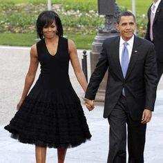 Michelle Obama in an elegant A-framed sleeveless black dress.