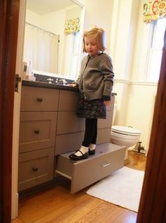 Hidden step stool for kids. Good to think about for the future.