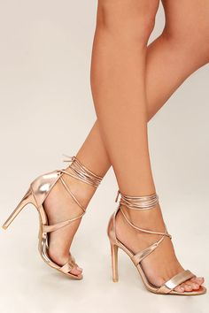 The Glamorous Top of the Class Rose Gold Lace-Up Heels have earned our vote of approval! Metallic rose gold vegan leather shines over a slender toe strap, structured heel cup, and long laces that wrap and tie around the leg.