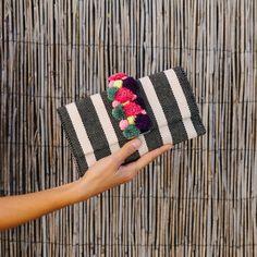 LR striped pom pom clutch