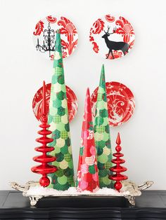 For a last-minute touch of cheer, gather your favorite holiday papers, make circle shapes with a paper punch, and apply the circles to foam cones with decoupage medium. Display the colorful trees on a platter with glass ornaments and fake snow.