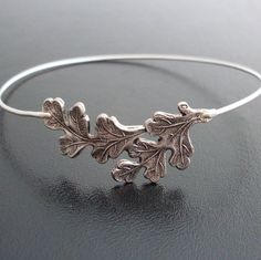 Oak Leaf Bracelet - Oak Leaf Jewelry - A collection of oak leaves in an antique silver finish has been transformed into a delicate oak leaf bangle bracelet with a silver filled band.    I can also make this oak jewelry with a .925 sterling silver bangle band for an additional $10. If you would like this option for your oak bracelet, select from options when ordering.    This oak tree jewelry also available in a gold finish;  http://www.etsy.com/listing/54134663/mistle...