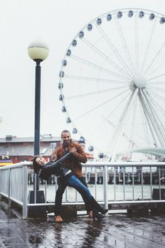 Awesome rainy Seattle engagement session photographed by Sparkfly Photography.