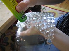 amazing idea for small centerpiece cups, bowls.. or wine bottles for the table numbering... could use purple and oranges and stuff... super freaking cool. glass beads bowl, DIY, tutorial, how to