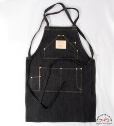 Bearing in mind that raw denim provides you protection from all harm (particularly when you're getting into the heavy stuff), Iron Heart have manufactured a raw denim apron (model with loads of pockets and rivets to boot. Barista, Jean Apron, Barber Apron, Patterned Jeans, Recycle Jeans, Apron Designs, Raw Denim, Work Wardrobe, Denim Fashion