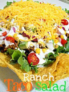 Ranch Taco Salad  1 head of green leaf lettuce 1 lb ground beef cooked with Homemade Taco Mix 1/2 cup corn 5 oz (about 16) cherry tomatoes, halved and seasoned with salt and pepper 1 avocado, diced 1/2 red onion, sliced or diced  1/2 cup ranch dressing 3/4 cup shredded cheddar cheese Cool Ranch Doritos Black Olives Poblano Peppers - Diced & cooked with meat