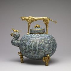 Wine Pot, China Cloissonné enamel, gilt bronze This is an entirely imaginary recreation, loosely based on the Zhou [Chou] Dynasty inlaid bronzes of the centuries BC. Vitreous Enamel, Teapots And Cups, Teacups, Chocolate Pots, Objet D'art, Chinese Antiques, Tea Set, Metal Working, Art Decor