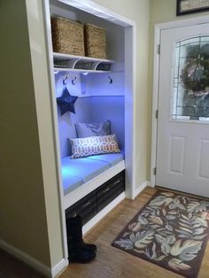 Turn a entry closet into a sitting nook to remove shoes