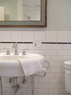 This beautifully tiled bungalow bathroom features American Standard's Standard Collection Console Vanity.
