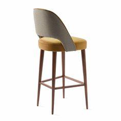 Chaise de bar AVA avec tissus dalmatien et pieds en bois massif.