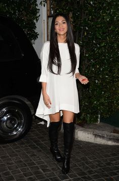 Nicole Scherzinger wears backless dress and over-the-knees boots at the Topshop Topman opening party in LA
