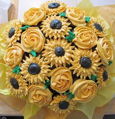cupcake flower bouquet.  can arrange in a flower pot with styrofoam ball.