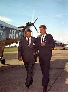 Wernher von Braun walking with President Kenne...