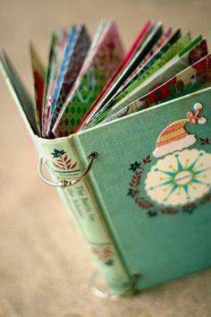 EU AMO esta ideia ... Use capa do livro antigo.  Colete cartões de Natal ou preenchê-lo com fotos do Natal da família!