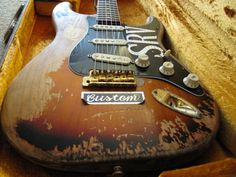 """SRV #1 a 62/63 Strat used by Stevie Ray Vaughan for most of his career, rebuilt several times. It had a curved rosewood fingerboard and was refretted so often that, after a while, it could not be refretted anymore. Martinez replaced it with the neck from """"Red,"""" an event often said to foretell Vaughan's death. This neck was destroyed when a piece of stage rigging fell on it. After Vaughan's death, the original neck was reinstalled on Number One."""