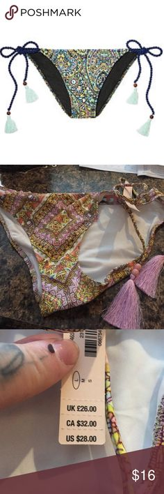 Victoria's Secret bikini bottom nwt Brand new with tags attached and in original packaging. First picture shows style only. Color is pink yellow orange pales. Victoria's Secret Swim Bikinis