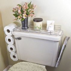 Hang these metal holders around the toilet to store toilet paper rolls, newspapers and other small items. http://hative.com/clever-toilet-paper-storage-or-holder-ideas/